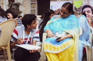 """Senior citizens share their life stories with young volunteers at a """"nostalgia activity"""" organized by iVolunteer in India"""