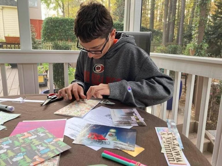 Will Kaiser making holiday cards and wreath for ActivateGood